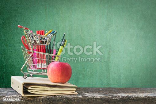 istock Welcome back to school concept with blank green chalkboard background with copy space for announcement 963350258