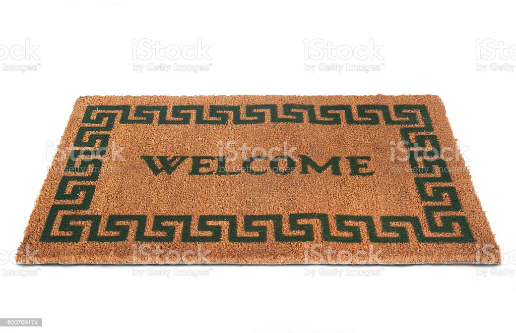 Welcome door mat isolated on a white background stock photo