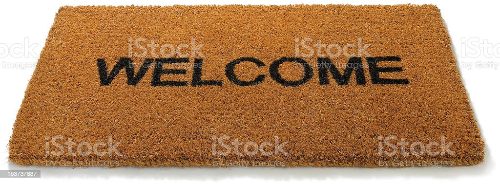 Welcome front door mat on a white background stock photo