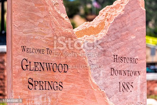 Glenwood Springs, USA - June 29, 2019: Welcome greeting sign for small Colorado town city in summer closeup in downtown
