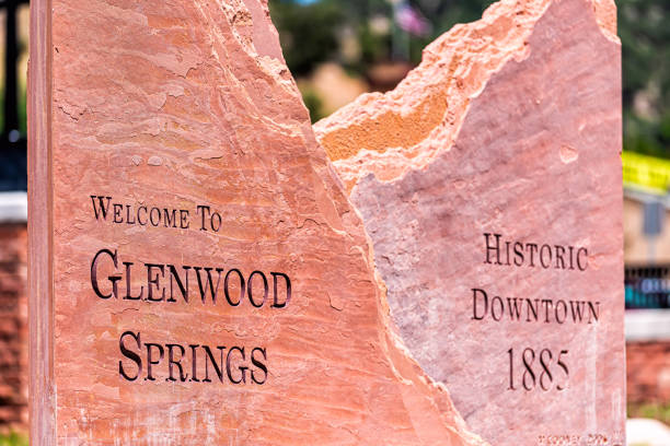 Welcome greeting sign for small Colorado town city in summer closeup in downtown stock photo