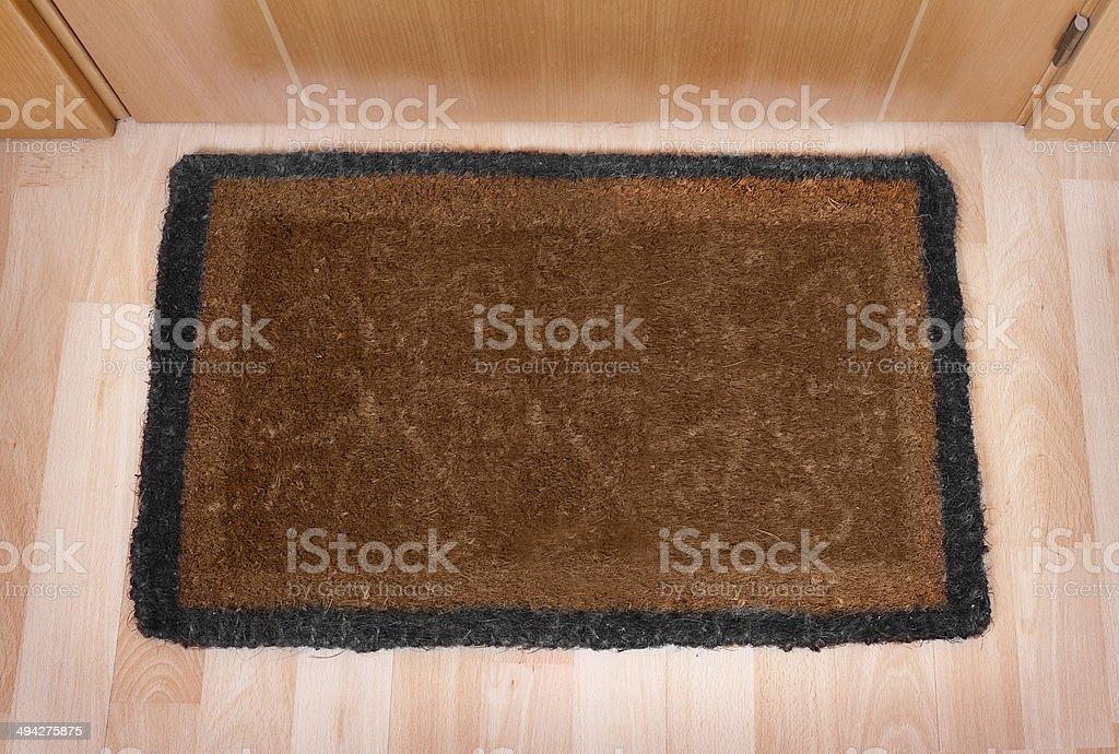 Welcome home doormat with closed door royalty-free stock photo