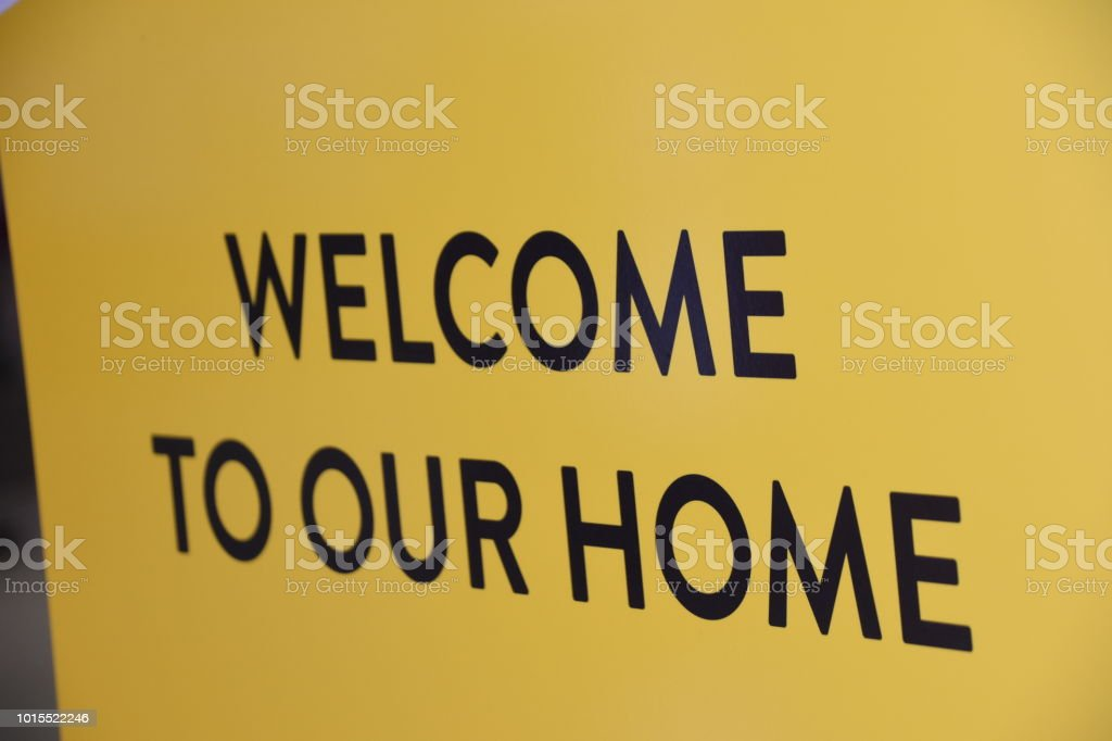 Sign Welcome Home In English And Spanish Stock Photo