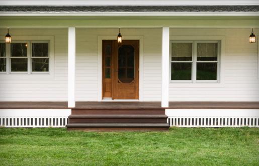Welcoming entrance of a modern farmhouse. Outdoor photography.