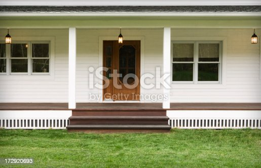 Welcoming entrance of a modern farmhouse. Outdoor photography.