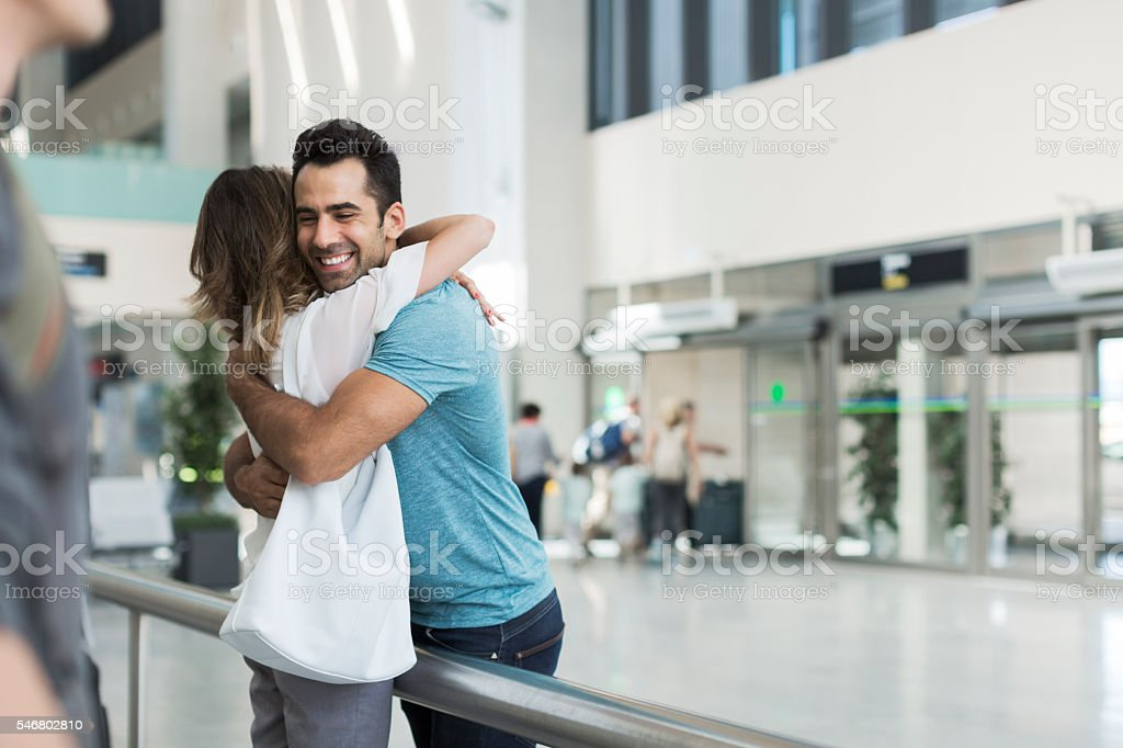 Welcome hug in the airport. stock photo