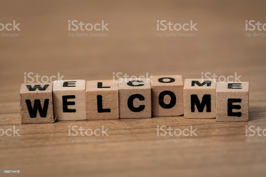 Welcome in wooden cubes stock photo