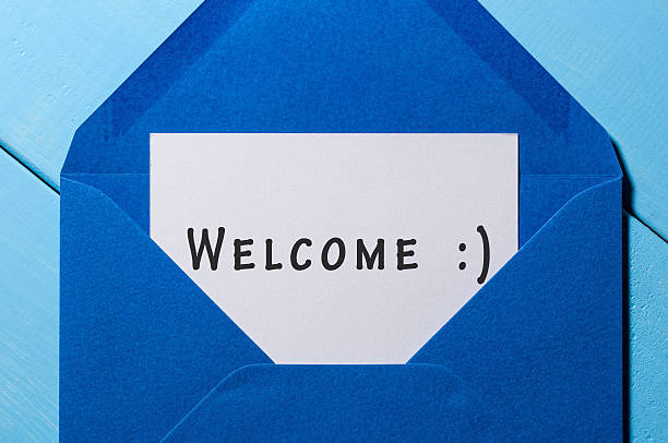 welcome inscription. hand drawn letter in blue envelope - welcome stock photos and pictures