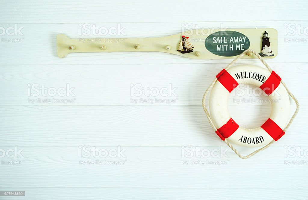 welcome Life ring hanging, wood background stock photo