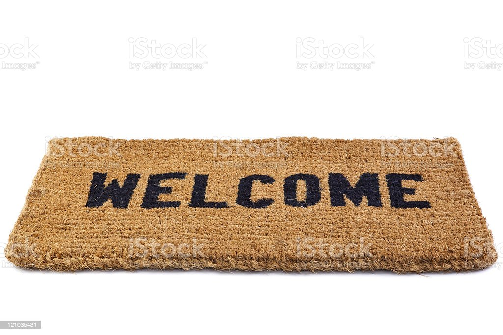 Welcome mat cut out stock photo