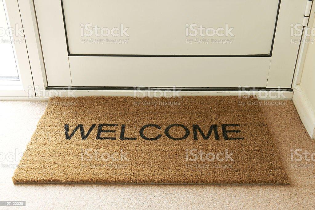 Welcome Mat Inside Doorway Of Home stock photo