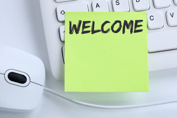 welcome new employee colleague refugees refugee immigrants computer business - welcome foto e immagini stock
