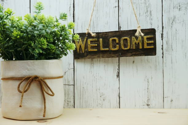 Welcome sign and home decor with space copy background Welcome sign and home decor with space copy background welcome sign stock pictures, royalty-free photos & images
