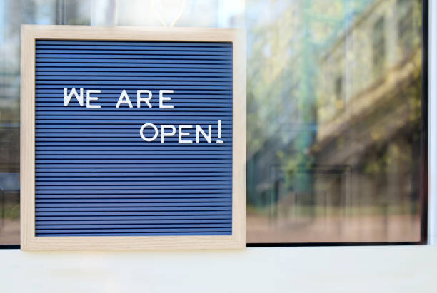 Welcome sign at the store/bar/restaurant. We are open. After COVID-19 quarantine stock photo