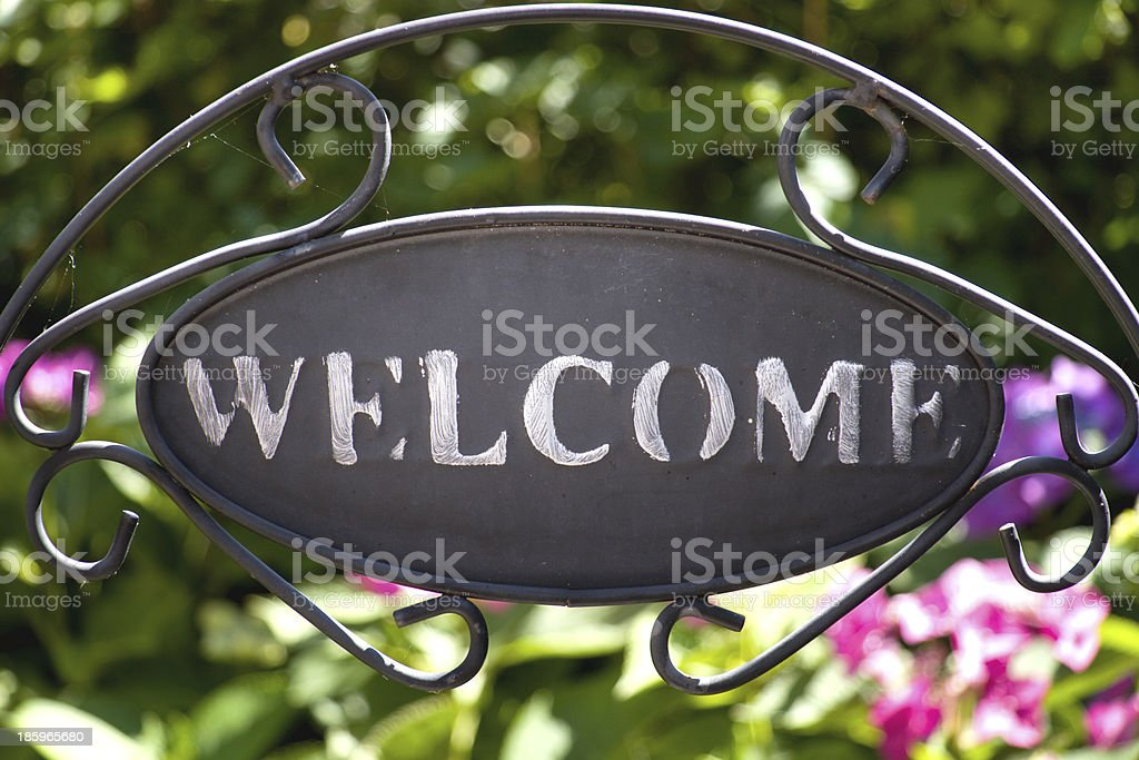 welcome sign in the garden stock photo