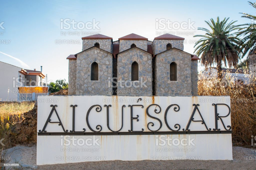 Welcome sign of the small village of Alcuescar with a model of Santa Lucia del Trampal stock photo