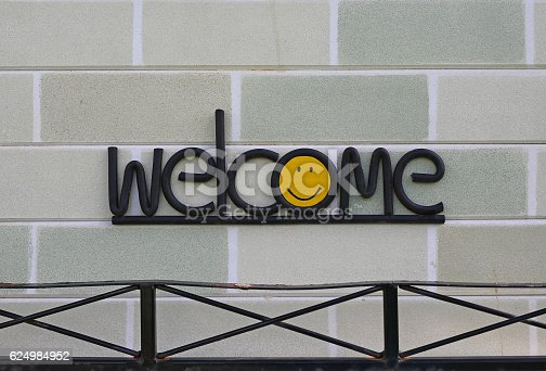 istock Welcome sign on brick wall 624984952
