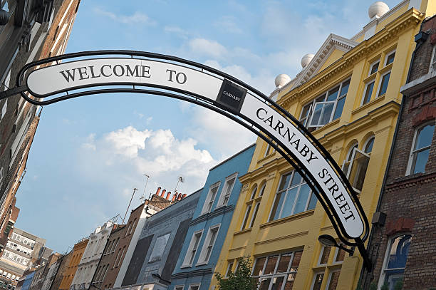Welcome sign on carney street in SoHo London Carnaby Street in Soho, London. carnaby street stock pictures, royalty-free photos & images