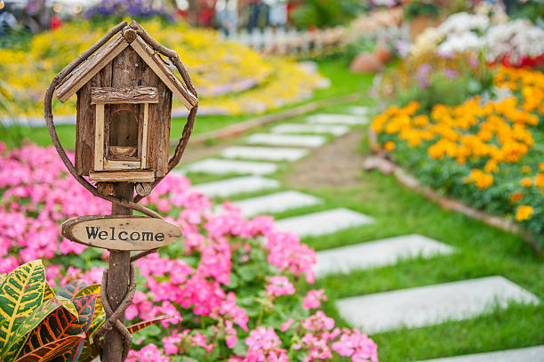 welcome sign on colorful garden - house with flowers stock photos and pictures