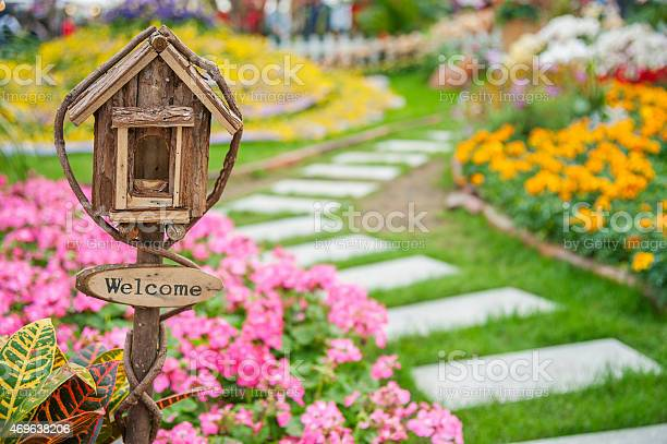 Photo of Welcome sign on colorful garden