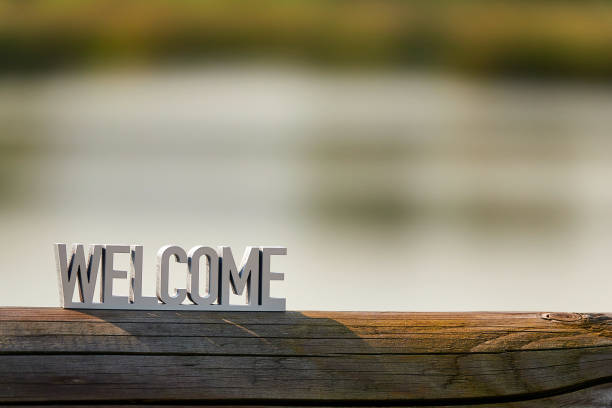 Welcome sign on outdoor background at sunset Welcome sign on window welcome sign stock pictures, royalty-free photos & images