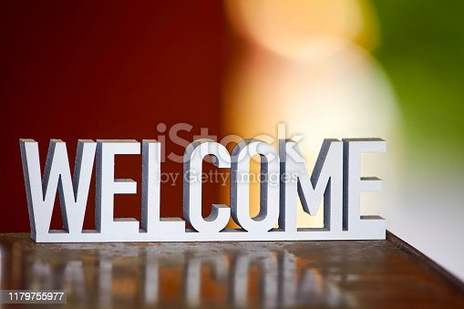 istock Welcome sign on warm hygge background 1179755977