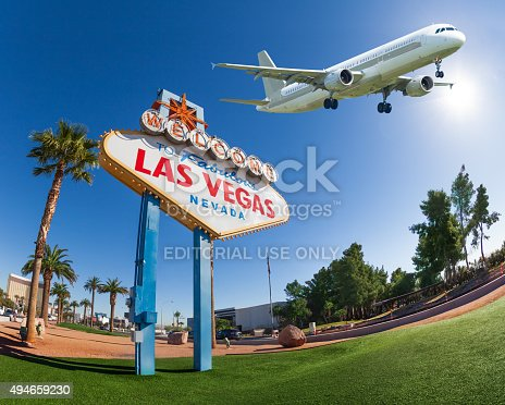 istock Welcome sign to Las Vegas with airplane in the sky 494659230