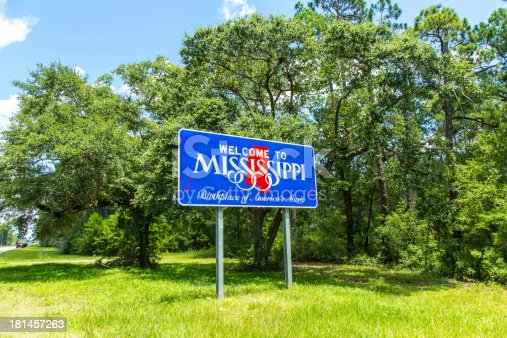 Red, white, and blue sign to welcome travelers to Mississippi - Birthplace of America's Music