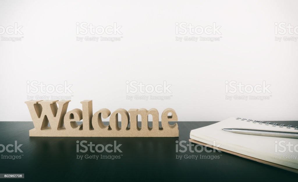 Welcome sign with notebook for office new staff concept stock photo