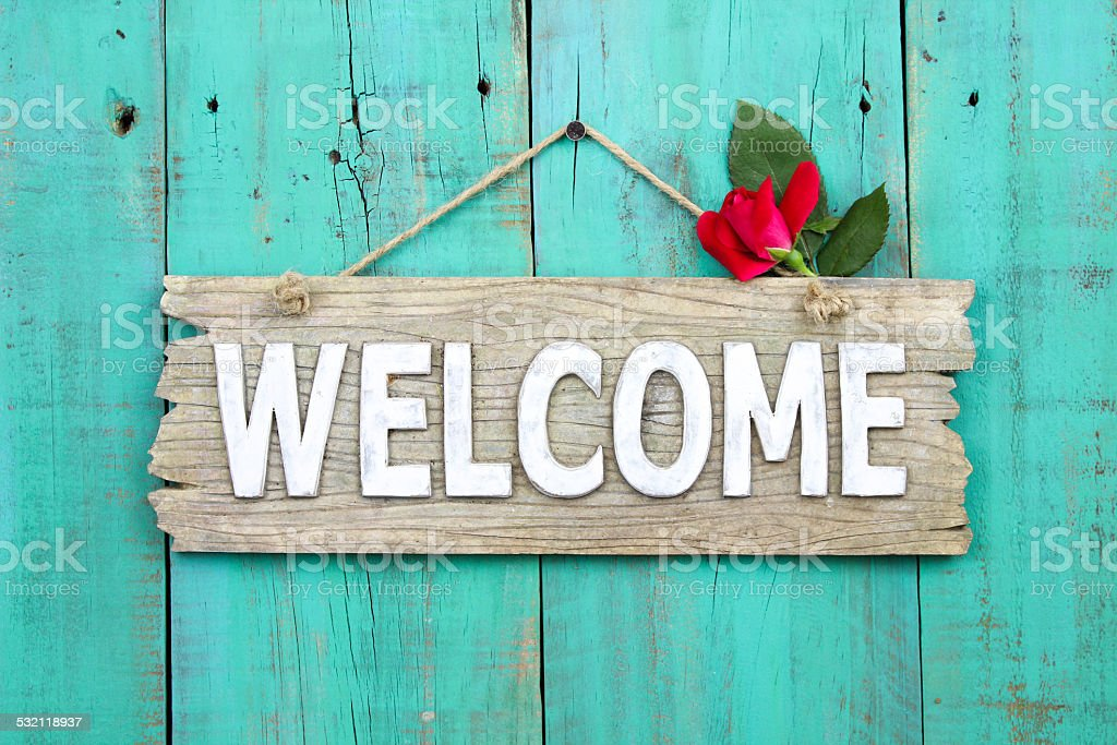 Welcome sign with red rose bud stock photo