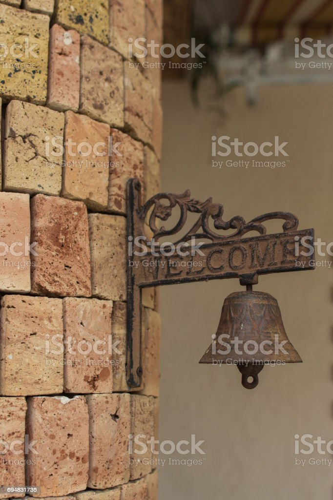 welcome sign with ring bell stock photo