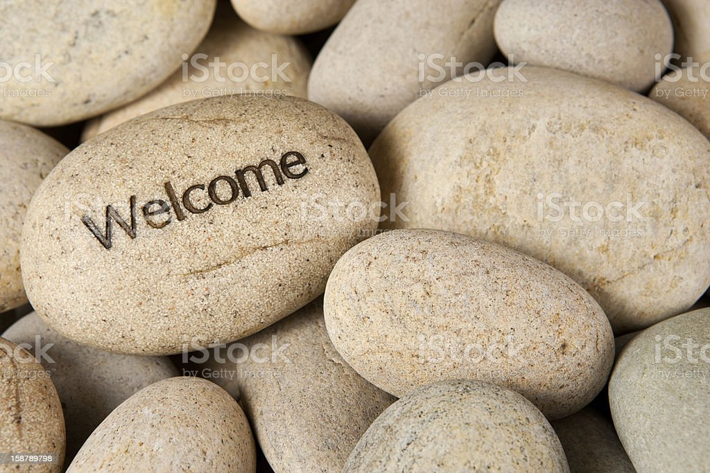 Welcome stone stock photo