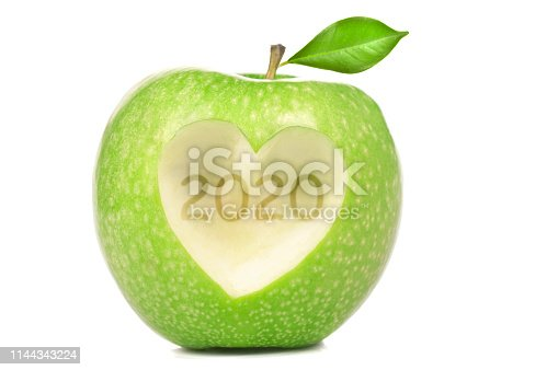 Green apple with heart shape of 2020 isolated on white