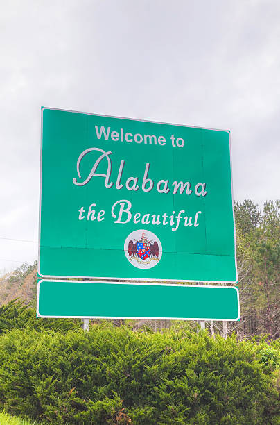 welcome to alabama the beautiful sign - place sign stock pictures, royalty-free photos & images