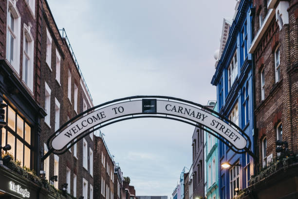 Welcome to Carnaby Street Sign over Carnaby Street, London, UK. Welcome to Carnaby Street Sign over Carnaby Street. Carnaby Street is a pedestrianised shopping street in Soho area of London. carnaby street stock pictures, royalty-free photos & images