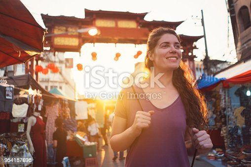 Female tourist in Chinatown of Chiang Mai, Thailand.