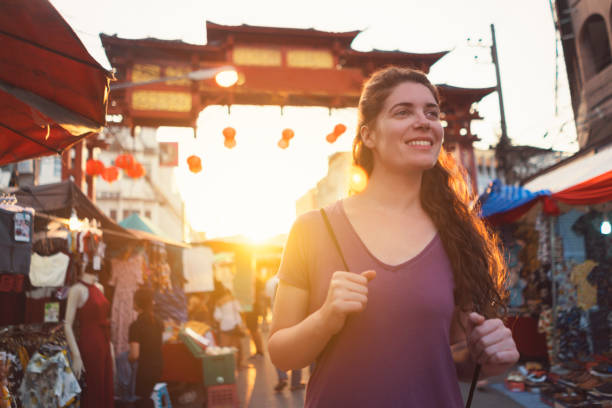 Welcome To Chinatown! Female tourist in Chinatown of Chiang Mai, Thailand. chiang mai province stock pictures, royalty-free photos & images