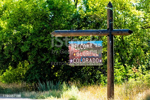 Bedrock, USA - August 14, 2019: Welcome to colorful Colorado sign closeup view from road highway with border to Utah in summer