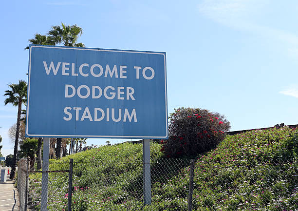 Welcome to Dodger Stadium Los Angeles, California, USA – March 17, 2014: A welcome sign at the entrance to Dodger Stadium in Los Angeles. The stadium has been home to the Dodgers Major League Baseball team since 1962. major league baseball stock pictures, royalty-free photos & images