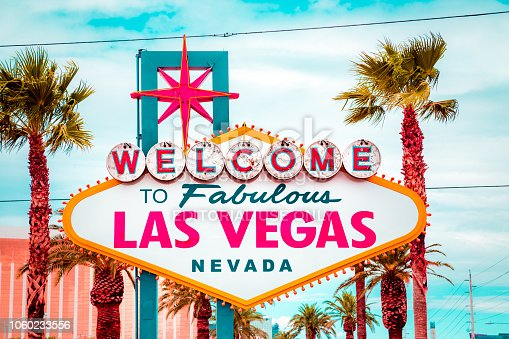 Classic view of Welcome to Fabulous Las Vegas sign at the south end of world famous Las Vegas strip on a beautiful sunny day with blue sky and clouds, Las Vegas, Nevada, USA