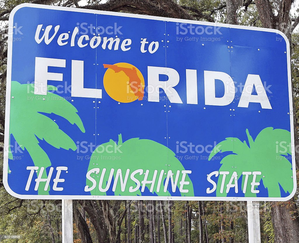 A welcome to Florida road sign stock photo