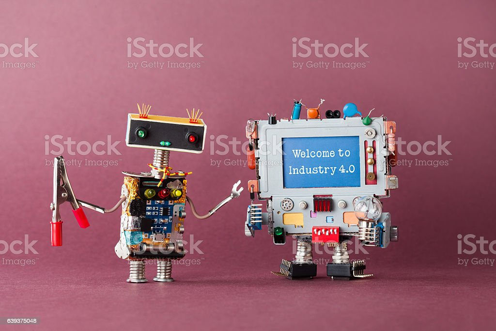 Welcome to industry 4.0 concept. IT specialist robot with stock photo