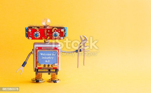 istock Welcome to industry 4.0 concept. IT specialist steampunk machinery robot, smiley red head, blue monitor body, pliers. New economic future message on blue display. Yellow background, copy space 682380078
