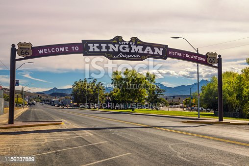 Kingman, Arizona, USA - October 24, 2018: Welcome to Kingman downtown, a wide arched street sign located on historic route 66.