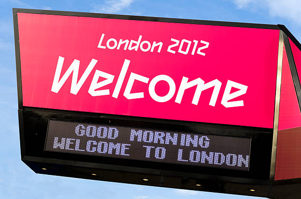 """Welcome to London 2012 - sign """"London, England - September 4, 2012: A bright Welcome sign at the entrance to the Olympic Park in Stratford, East London. There were several of similar signs in a row, each flashing a message along the bottom of the sign."""" 2012 stock pictures, royalty-free photos & images"""