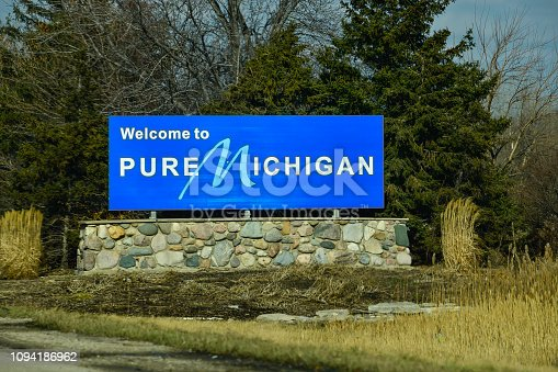 A sign on the Ohio/Michigan border welcomes visitors to the state of Michigan.