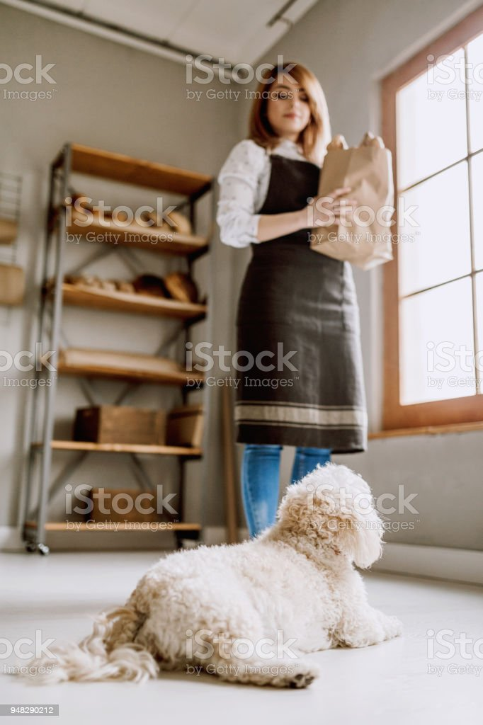 Successful Female Entrepreneur Standing Confidently In Her Own Bakery...