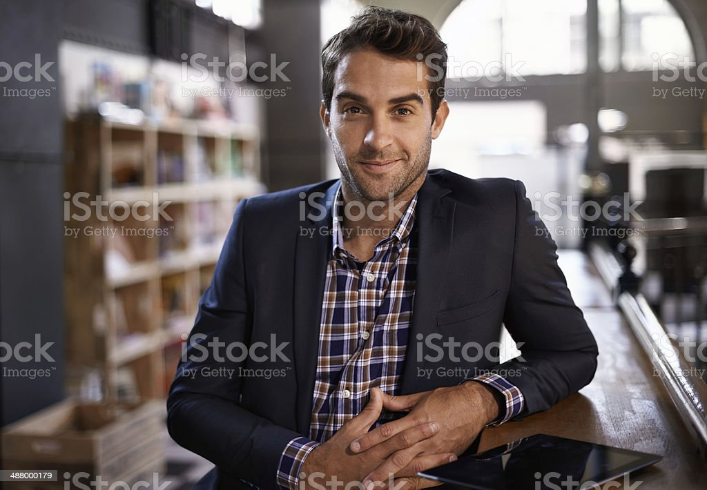 Welcome to my pub Portrait of a handsome young man standing next to a bar counter 30-34 Years Stock Photo