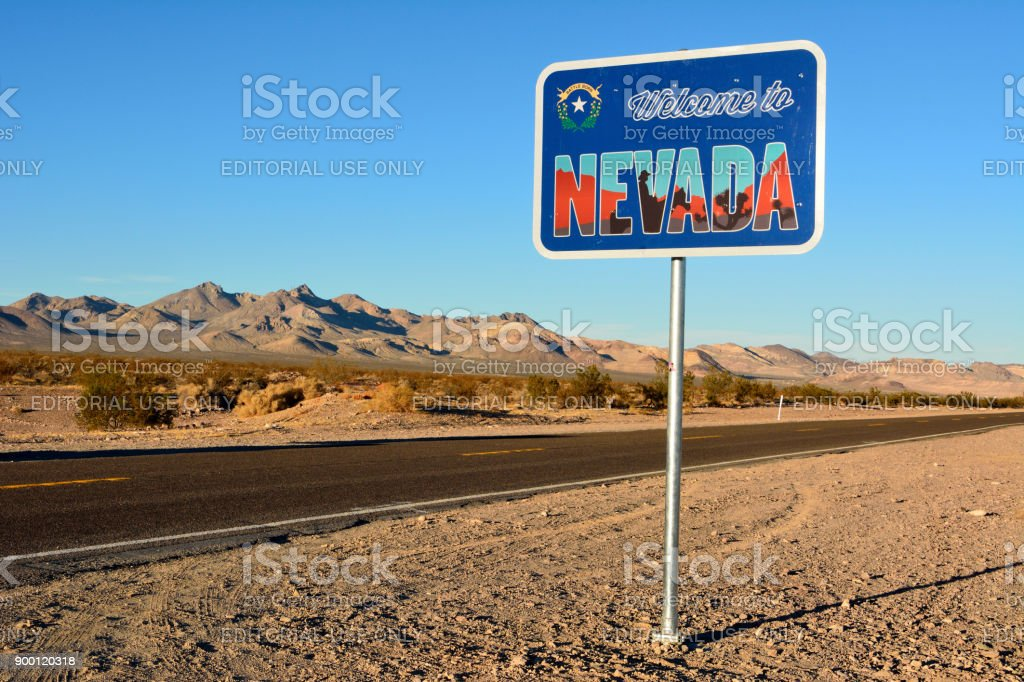 Welcome to Nevada road sign along a highway. stock photo
