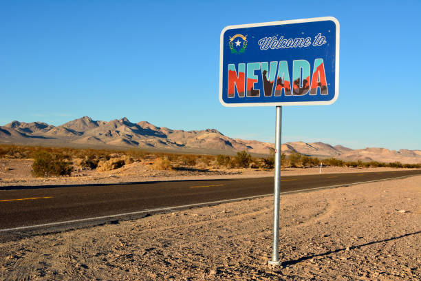 Welcome to Nevada road sign along a highway. Beatty, Nevada, United States of America - November 23, 2017. Welcome to Nevada road sign along a highway. nevada stock pictures, royalty-free photos & images